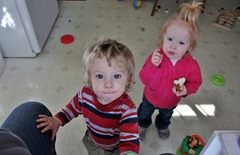 Theodore and Jacqueline and are interested in my camera while in Grammy's kitchen.