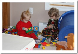 Jacqueline and Theodore play with Lego's on the family room floor.