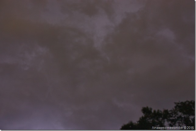 020 Lightning flashes from behind the dark clouds