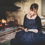 Ange Hardy sitting in front of Coleridge fireplace