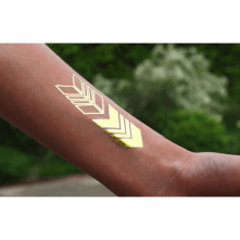 gold-arrows-tattoo-