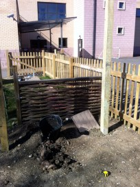 Greenhouse posts being cemented in