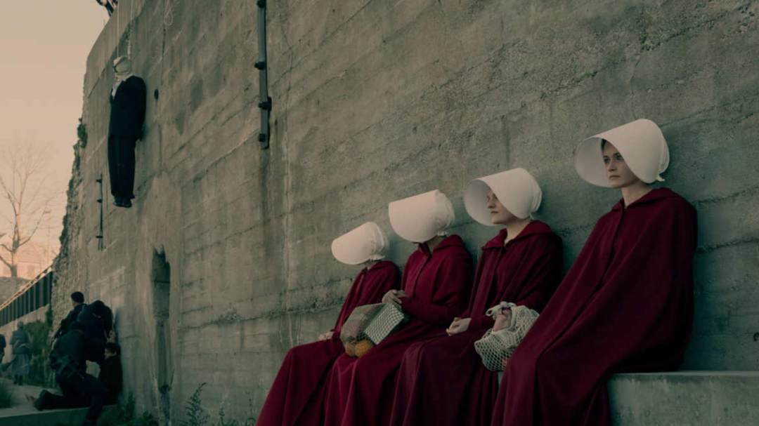 Handmaids sitting. It's a whirl-wind, action-packed, thrill-ride!