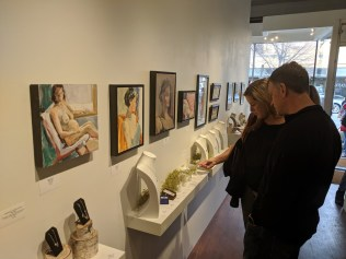A wall of figurative art and art jewelry