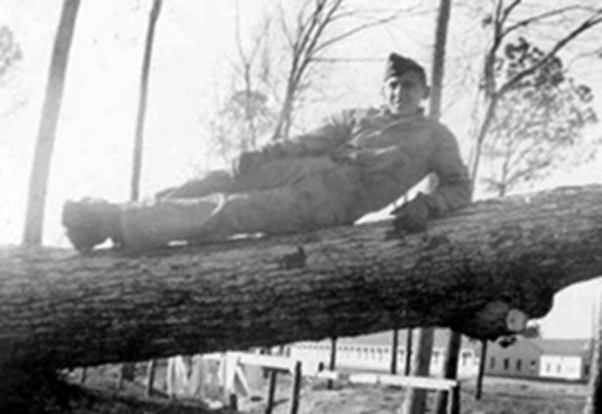 Ed DuBeck relaxes in a tree between drills.