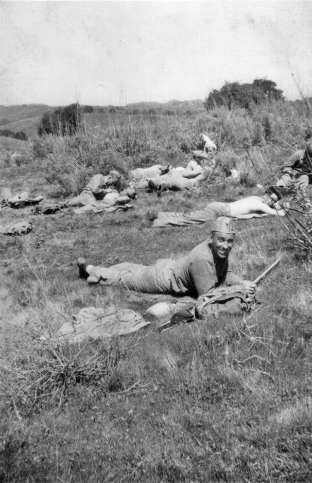 """Gunny Russell during a field exercise. Russell was known for being """"squared away"""" at all times, as evidenced by the perfect placement of his garrison cap even during a rest break. Camp Pendleton, 1943."""