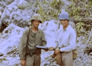 """Americans posing with a Japanese grenade launcher (""""knee mortar"""") recovered from the scene of the charge."""