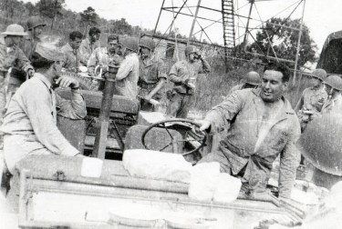 Taking five around the Jeeps. The pedestal between the seats could mount a machine gun in combat.