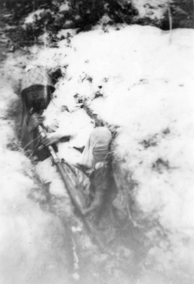 """One of Namur's defenders taught an object lesson in the Japanese fighting mentality of the time. """"Suicide - pulled trigger with toe. Never surrendered."""""""