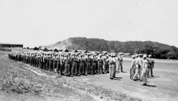 There were a number of formal occasions that necessitated parades, especially in 1945. Here, a company stands by to step off.