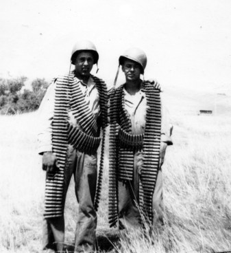 """Pinkie"" - Melvin Pinkerton - and John Pope, festooned with ammunition for a .50 caliber machine gun."