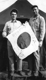 Curly Klauss and Haynes pose with a souvenir.