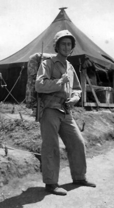 """Curly Klauss in full field gear, Camp Maui. Note the distinctive """"411"""" UNIS mark on his canteen."""