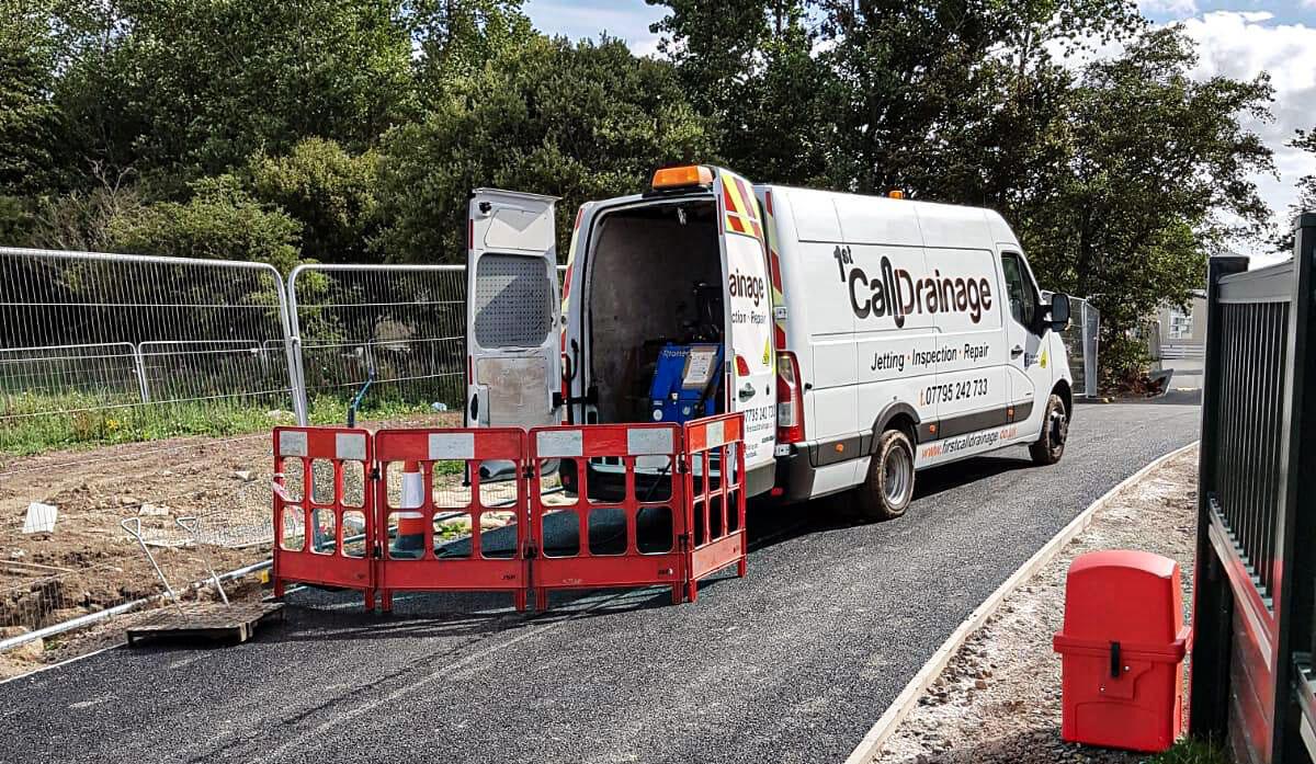1st call heating & drainage - Van working on external drain