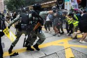 Hong Kong police make first arrests under new security law; fire water cannon, pepper balls as thousands protest