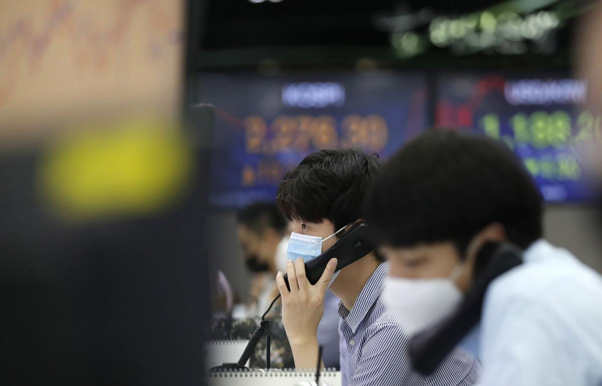 Global stocks sink after Fed virus warning, eyes on GDP data
