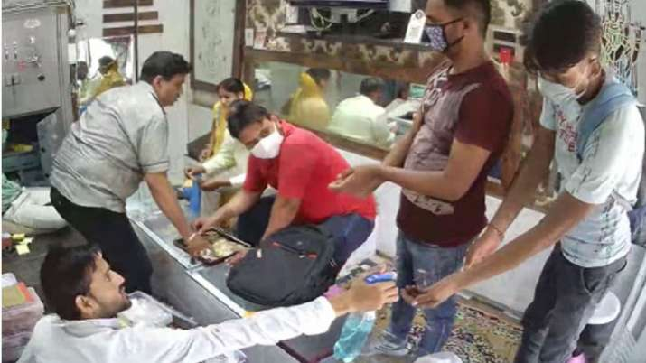 Robbers sanitise their hands before looting a jewellery store in Aligarh