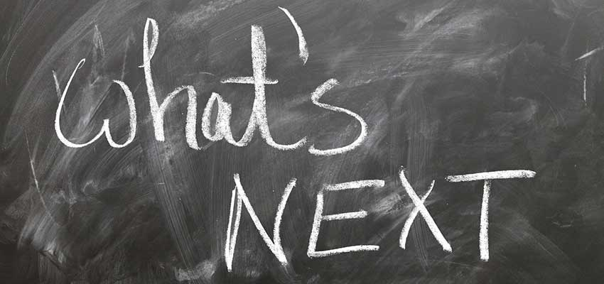 """Chalkboard with """"What's Next"""" written on it."""