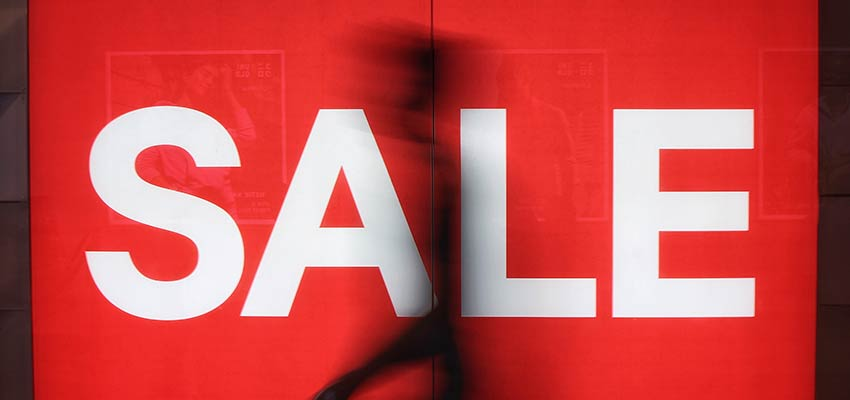 """A sign that reads """"SALE""""."""