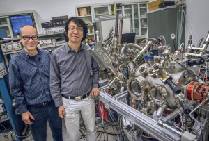 Andreas Schmid and Gong Chen at the SPLEEM instrument in the Molecular Foundry's electron microscopy center where they are conducting research on magnetic domain walls. (Photo by Roy Kaltschmidt)