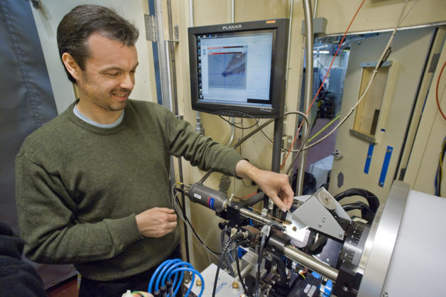 Photo - Simon Teat, a Berkeley Lab staff scientist, is shown here at the Advanced Light Source's Beamline 11.3.1, which specializes in structural studies of crystallized chemical samples using X-rays. This beamline was used to study the structure of glowing crystals designed to detect and trap heavy metals. (Credit: Roy Kaltschmidt/Berkeley Lab)