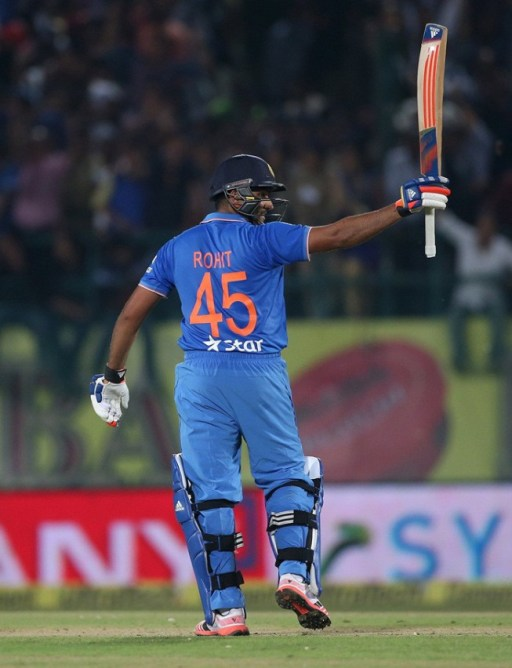 India's Rohit Sharma celebrates after completing his century during their first Twenty-20 cricket match against South Africa in the northern Indian hill town of Dharamsala, India, October 2, 2015. REUTERS/Adnan Abidi