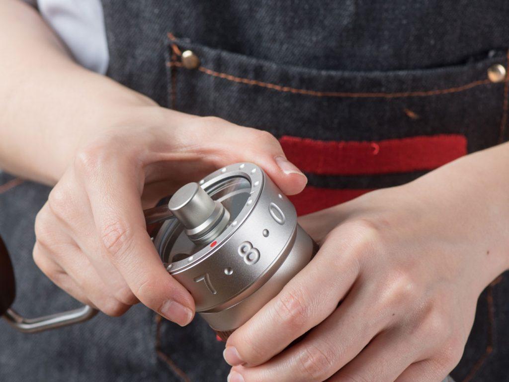 Barista adjusting the grind setting of K-Pro grinder