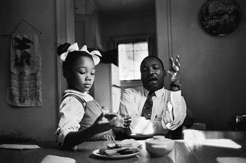 "newfilosofee:think4yourself:julyshewillfly:      King said in an interview that this photograph was taken as he tried to explain to his daughter Yolanda why she could not go to Funtown, a whites-only amusement park in Atlanta. King claims to have been tongue-tied when speaking to her. ""One of the most painful experiences I have ever faced was to see her tears when I told her Funtown was closed to colored children, for I realized the first dark cloud of inferiority had floated into her little mental sky."" (TIME)"