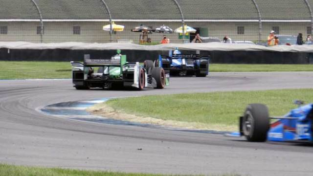 "The racing ""surface"" in Turns 9 and 10 often includes the grass."