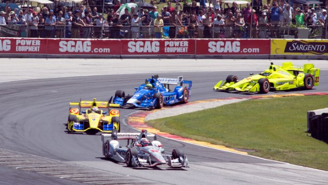 Will Power leads the field in Turn 5 during the opening lap of the KOHLER Grand Prix at Road America