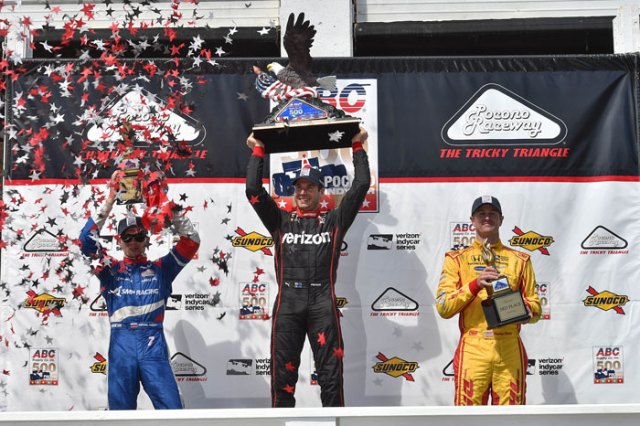 The podium of Will Power, Mikhail Aleshin, and Ryan Hunter-Reay hoist their trophies in Victory Circle following the ABC Supply 500 at Pocono Raceway