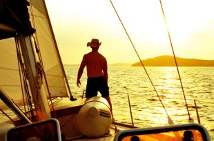 Sailing into the sunset, from Paradise, Mykonos, to Chora, Mykonos.