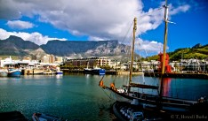 Table Mountain looms over the city, impossible to ignore - you feel it even with your back turned.