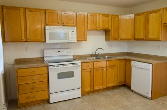 Kitchen has stove, microwave, dishwasher, and refrigerator and plenty of counter space.