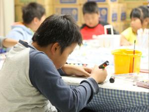 NICCO staff help children from Natori.