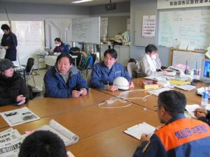 Peace Winds Japan staff meet with personnel at the Kesennuma disaster response headquarters.