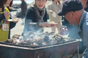Festival visitors enjoy the steamed oysters in Ishinomaki.