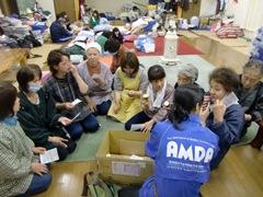 AMDA staff distributing vitamins as part of their nutrition program.