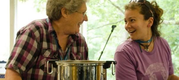 Volunteer Donna laughs with 2014 Volunteer Coordinator Jenn Cloke