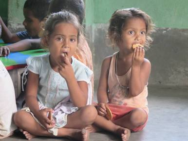 Two Indian students having a snack. Photo by Jamie.