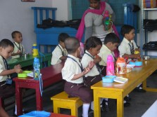 Nursery students eating lunch at the English medium school (Photo by Jamie)
