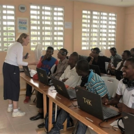 Rose teaching class at St. Francis School of Technology
