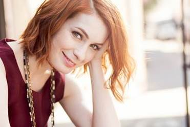 Photo of keynote speaker Felicia Day leaning head on hand and smiling