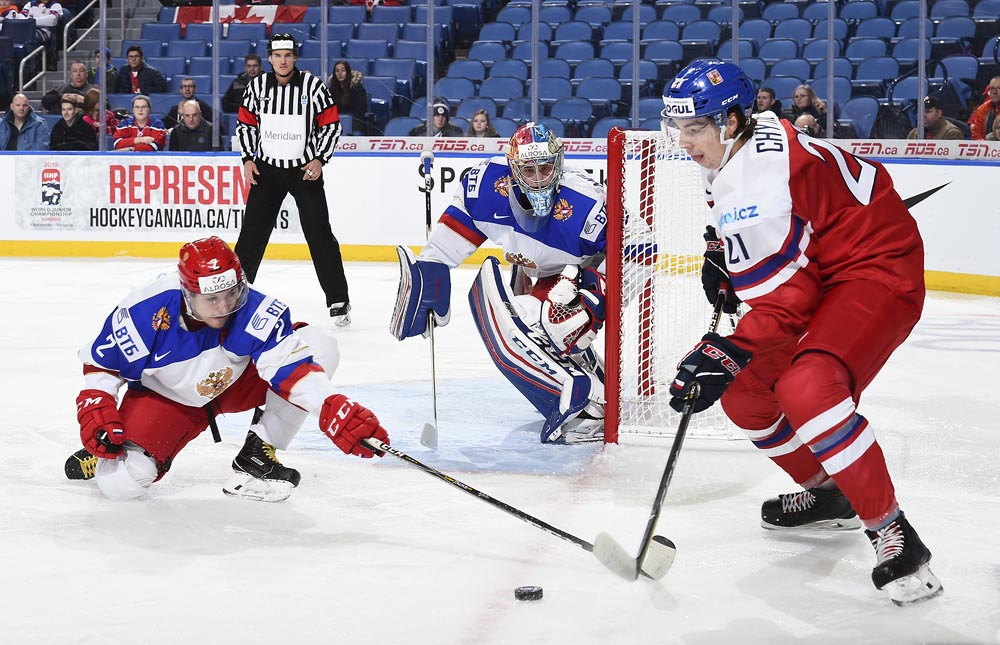 974ae7464 ... chance against Russia s Alexei Melnichuk  1 while Nikita Makeyev  2  defends during preliminary round action at the 2018 IIHF World Junior  Championship.