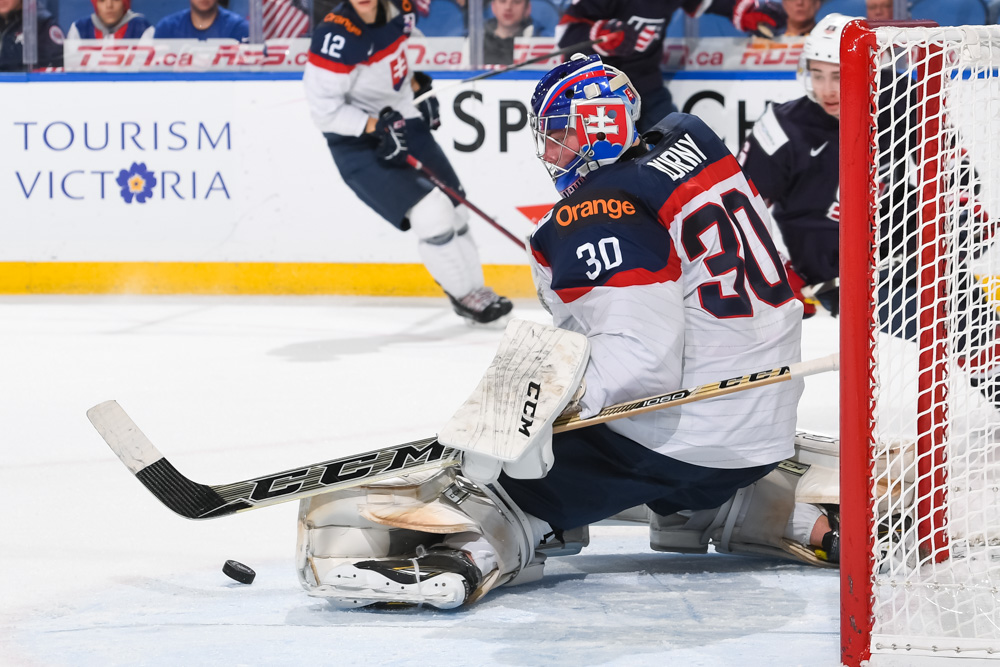 ab5af1a0e Slovakia s Roman Durny  30 makes a pad save against USA during the preliminary  round of the 2018 IIHF World Junior Championship.