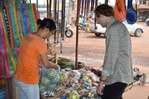 8:15: Quick stop at a Chinese stall to buy Sepak Takraw balls for the Ban Sikeud pupils who are now students at the Lao-German Technical College