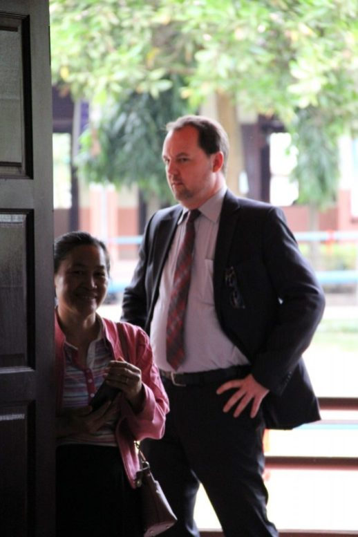 Mrs Hanthavong and Mr Heller watch