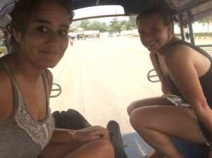 Not even safe from water in the tuk-tuk (desperately trying to protect our backpacks)