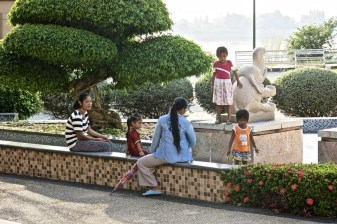 Children and their mothers playing in front of a hotel, Vientiane