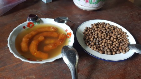 Pickled tamarind and little nuts that taste similar to chestnuts, offered by one of Khamsee's many friends in Sam Neua